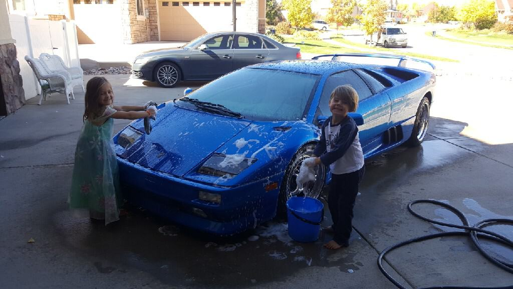 kids washing Lamborghini Diablo